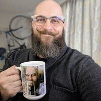 a picture of the author drinking from a coffee mug with a picture of himself drinking from a coffee mug with a picture of himself drinking from a coffee mug. This joke has gone on for far too long, but he shows no signs of ceasing to make more mugs.